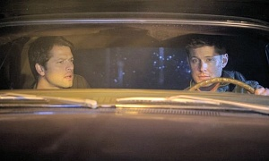 Castiel rides alongside Dean in a car that isn't the Impala.