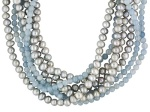 This necklace has 5 strands of silver pearls and 3 strands of aquamarine beads.