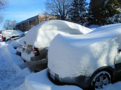 "A picture of snow drifts on my car from the ""Snowmageddon"" of 2009."