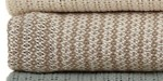 This is a cotton throw in tan and beige.