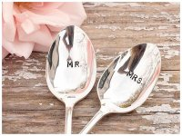 "One silver spoon is engraved ""MR.""  The other is engraved ""MRS."""