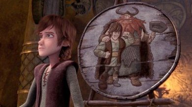 Hiccup stands in front of the misleading portrait.
