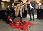 Castiel and Dean investigatae a fallen anvil.