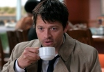Castiel enjoys a cup of coffee.