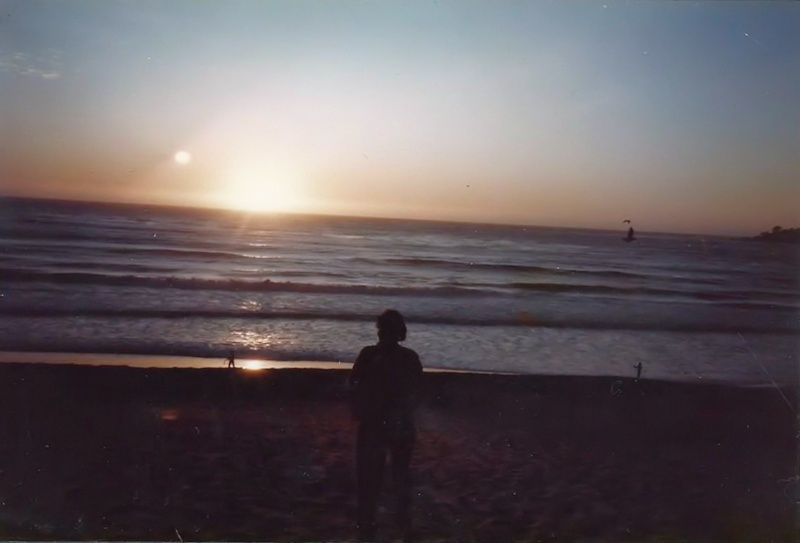 I watch as the sun sets over the Pacific Ocean.