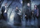 The cast of Sleepy Hollow poses in the forest.