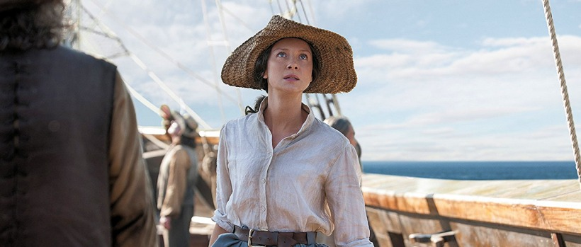 Claire rocks a straw hat.